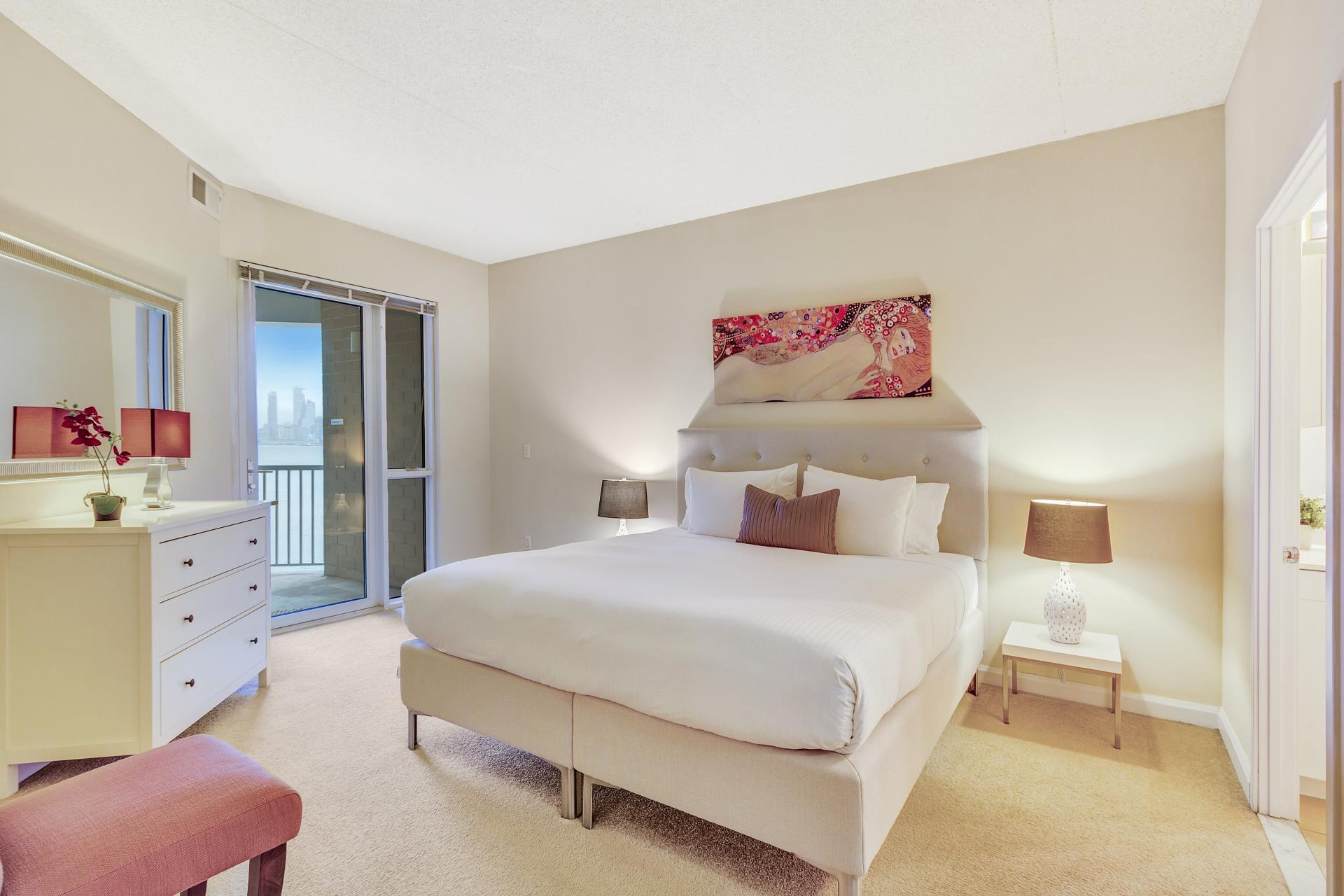 Bedroom at Exchange Place Station Apartments