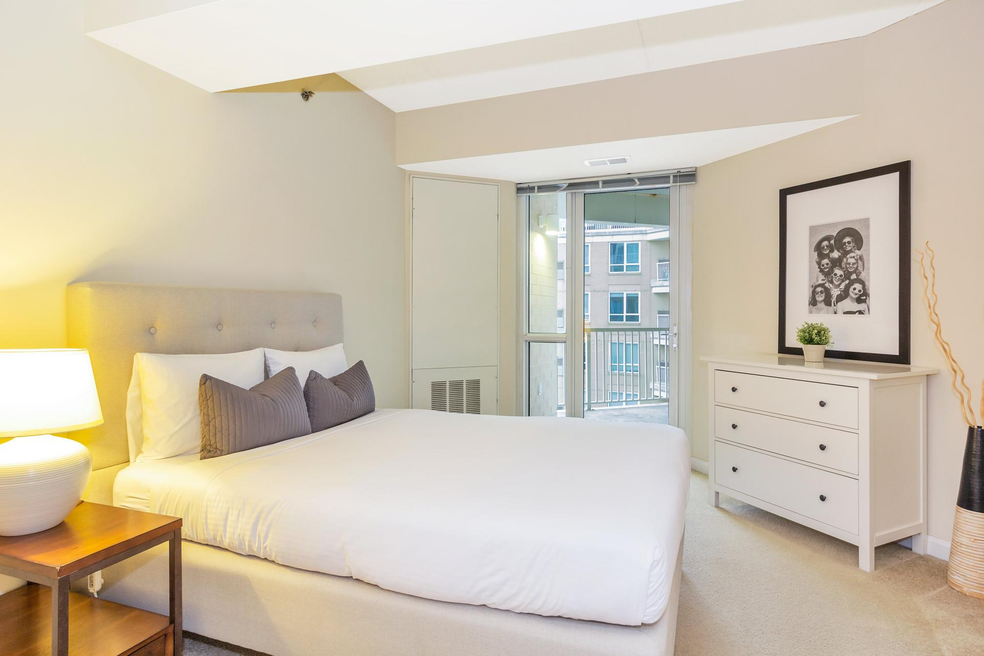 Bed at Exchange Place Station Apartments