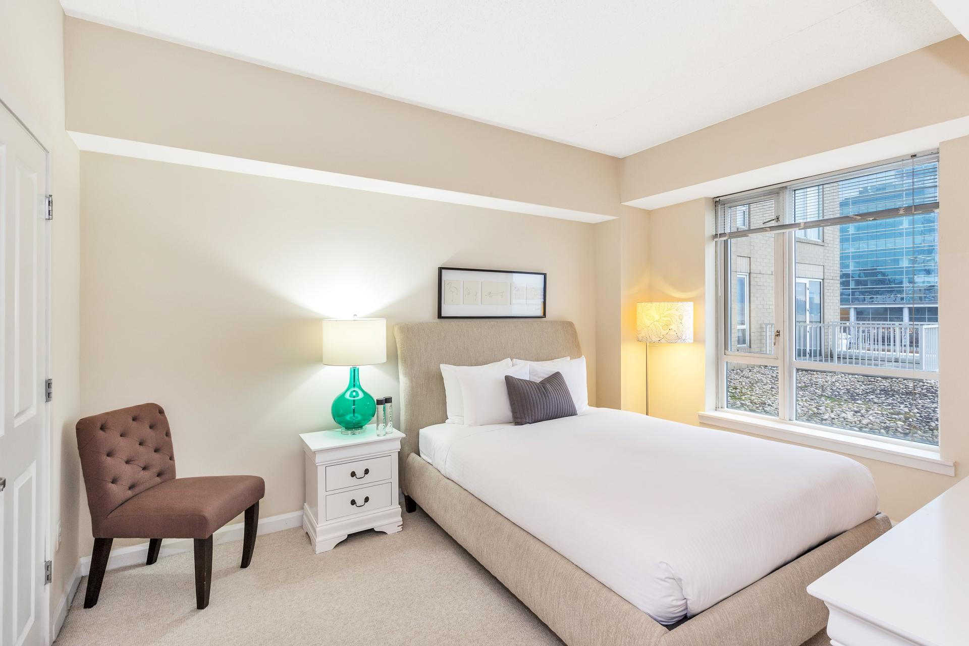Bright bedroom at Exchange Place Station Apartments