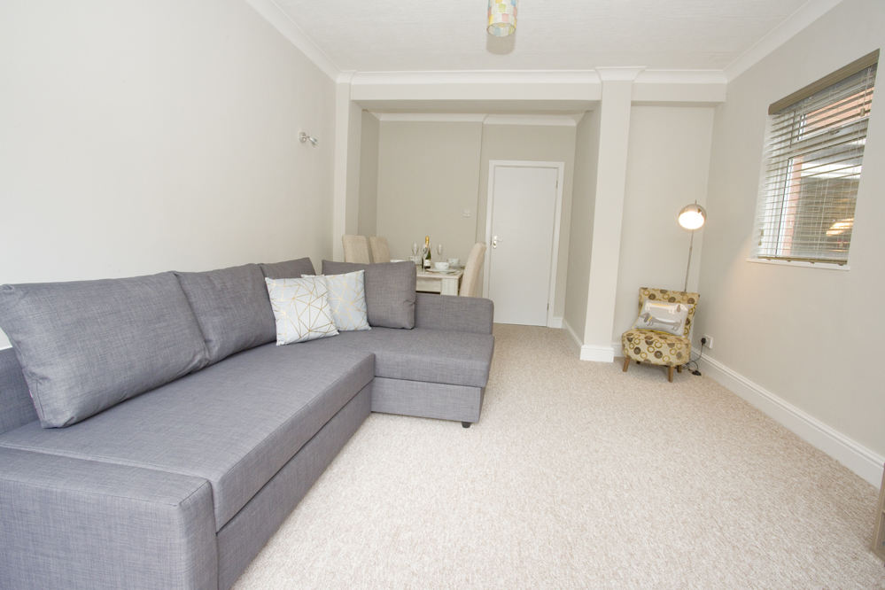 Comfortable living area at Chine Gardens Apartment
