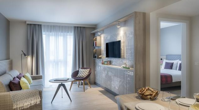 Living room at Citadines Arnulfpark Apartments