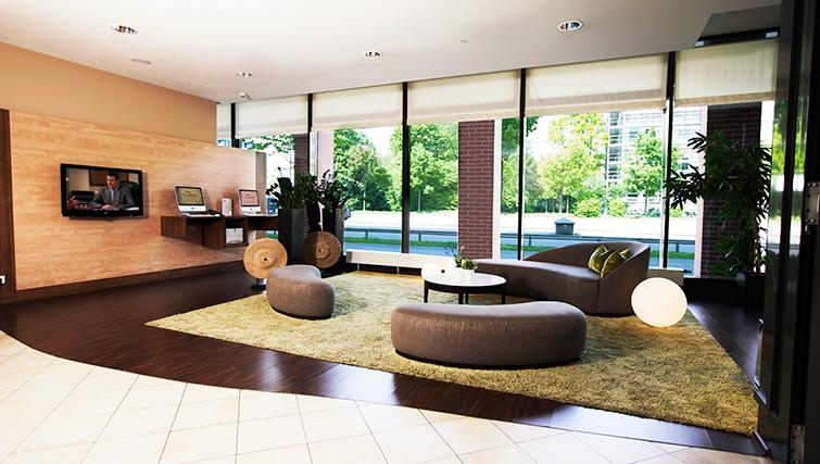 Communal lounge at Citadines Arnulfpark Apartments