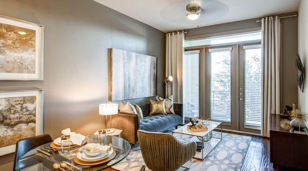 Living room at Alara Uptown Apartments