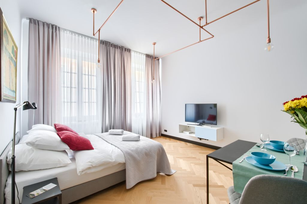 Sleek bedroom at Old Town Square Apartments
