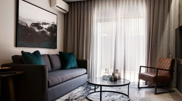 Living room at The Capital Melrose Apartments