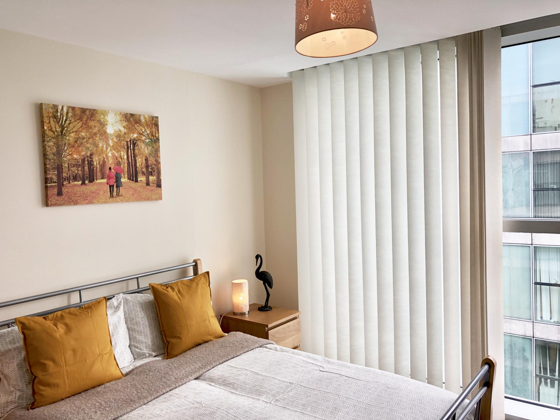 Bright bedroom at The Hub Serviced Apartments