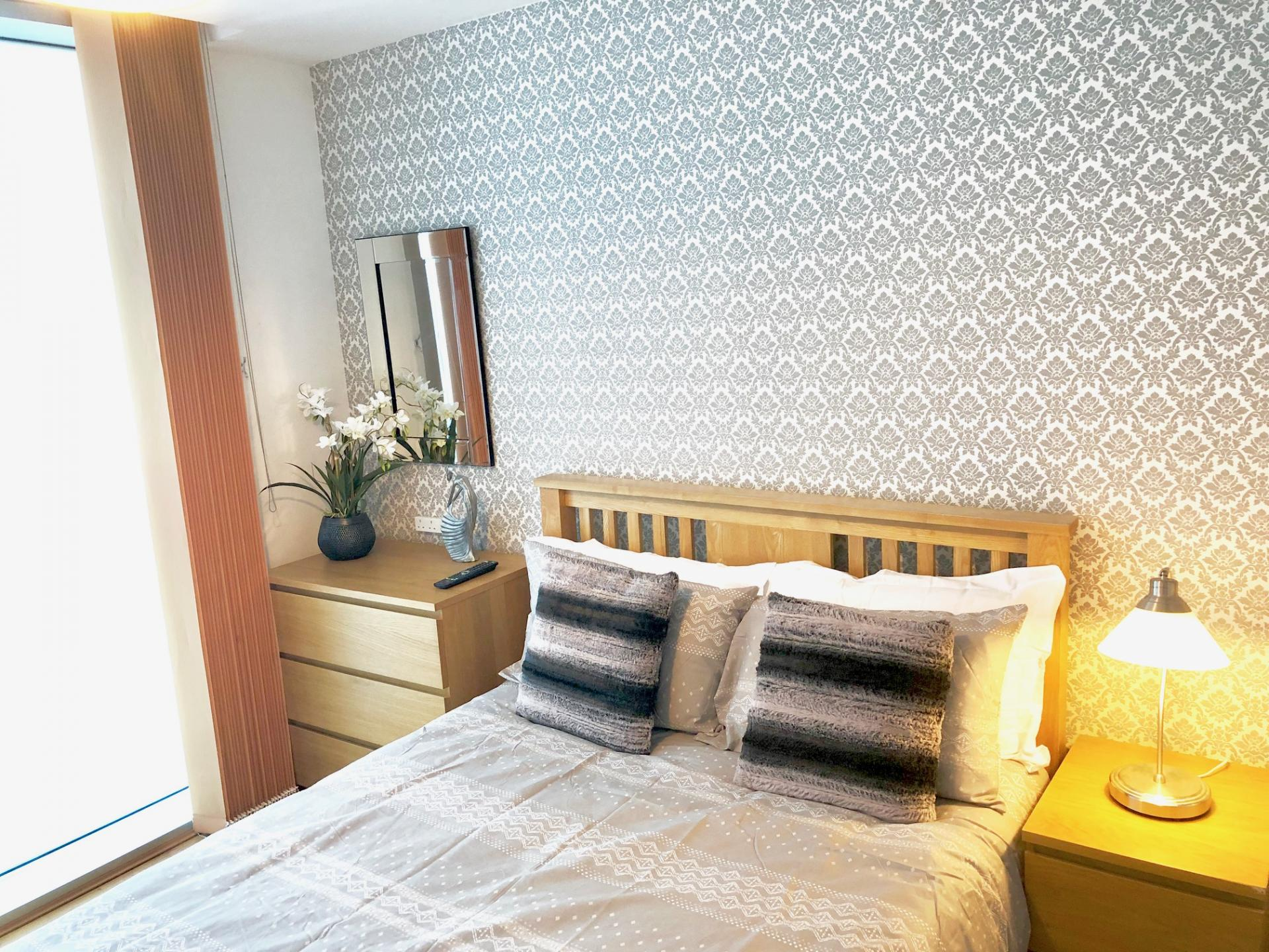 Comfortable bed at The Hub Serviced Apartments