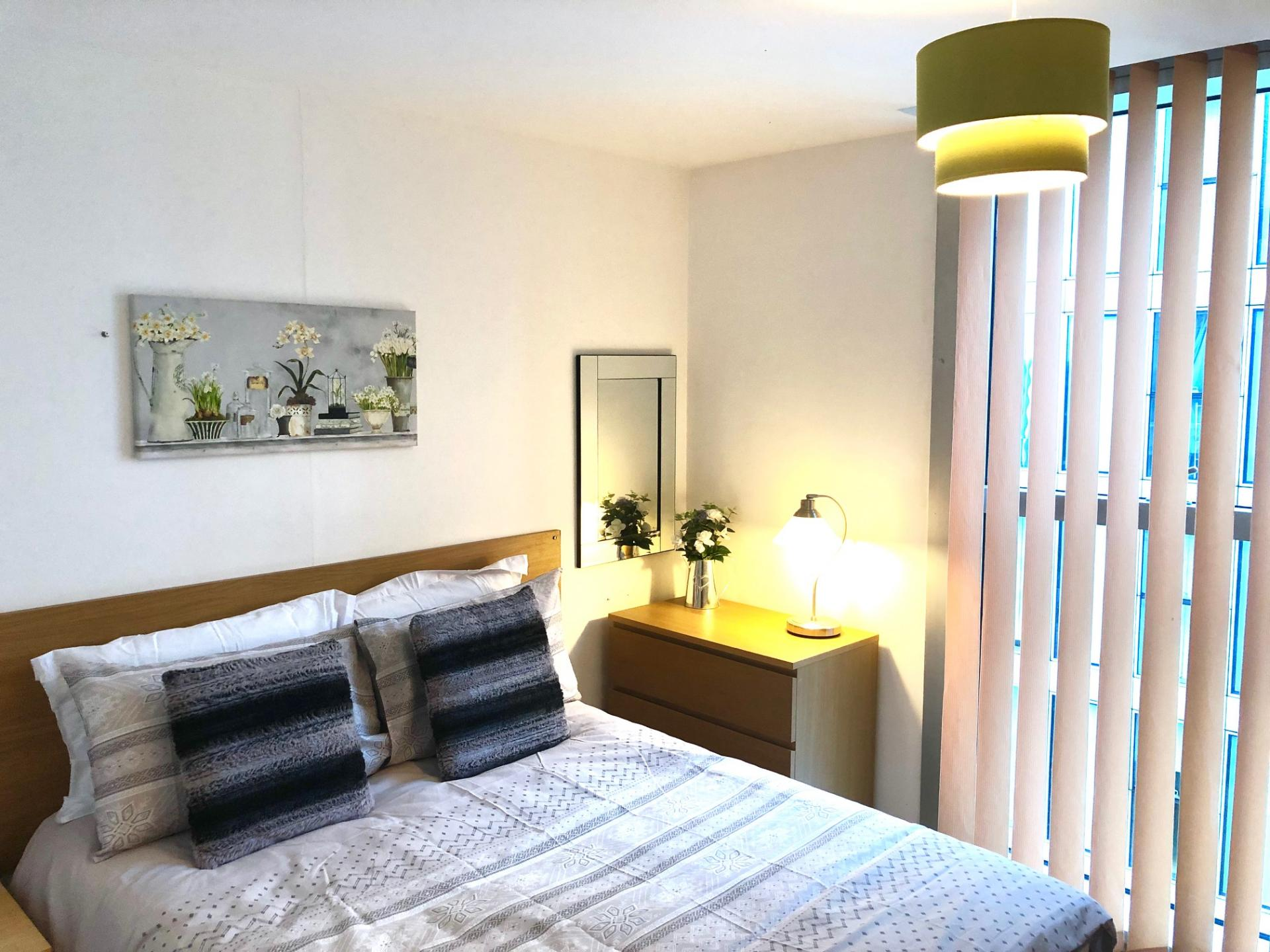 Comfortable bedroom at The Hub Serviced Apartments