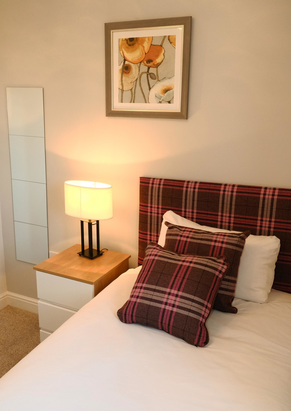 Stylish bedroom at Knightsbridge Court Apartments