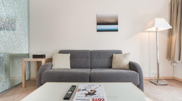 Living room at Acacias Apartments