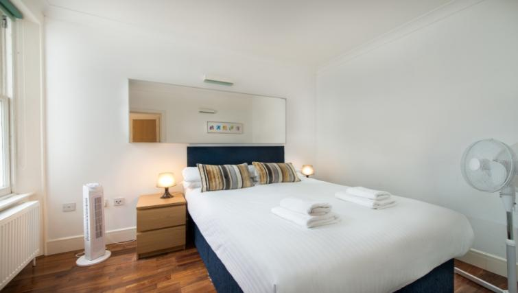 Double bed at High Street Kensington Apartments
