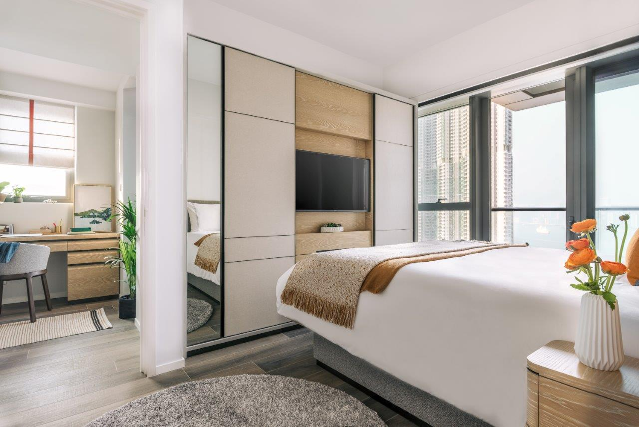 Modern bedroom at Waterfront Suites Apartments