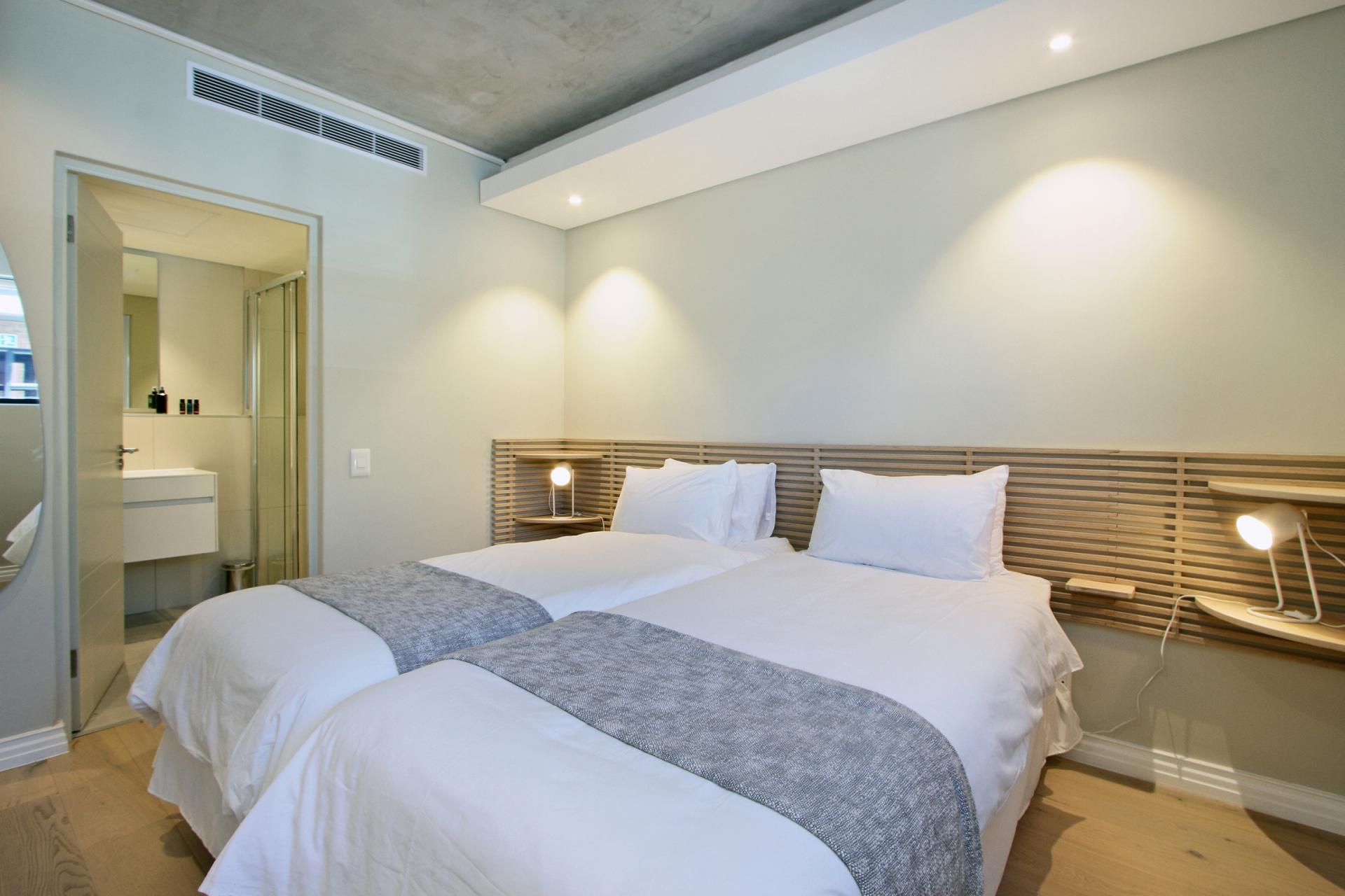 Twin beds at Docklands Cape Town Apartments, Green Point, Cape Town