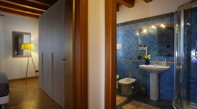 Bedroom/bathroom at Rosà VI Apartment