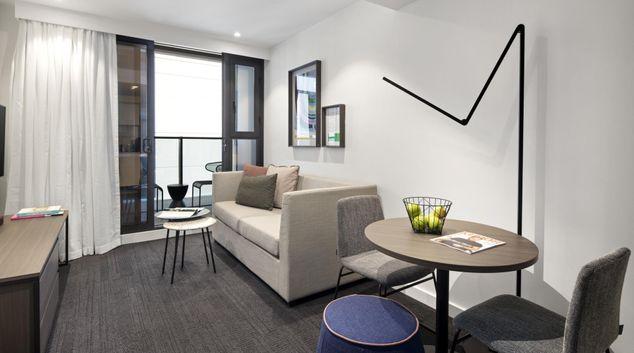 Living room at Quest St Kilda Road Apartments