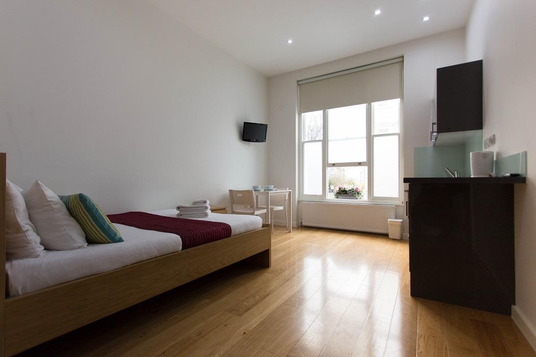 Bright bedroom at  Ladbroke Studios and Apartments