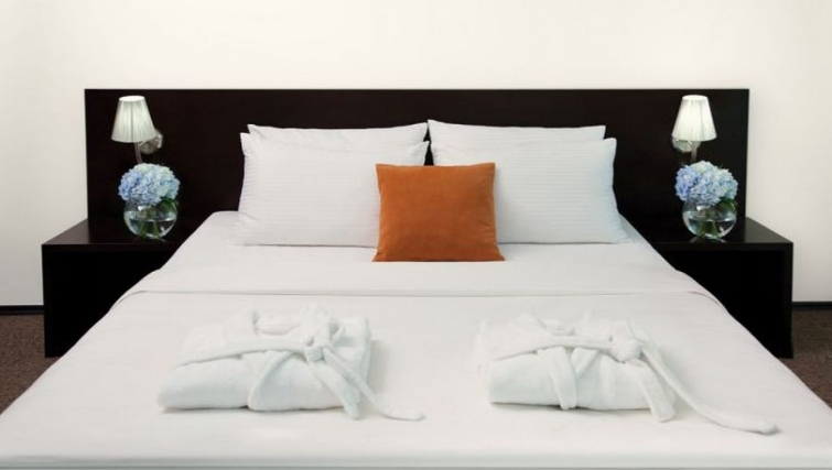 Stylish bedroom in Citadines Freedom Square Apartments