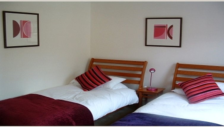 Twin bedroom in Manor House Apartments