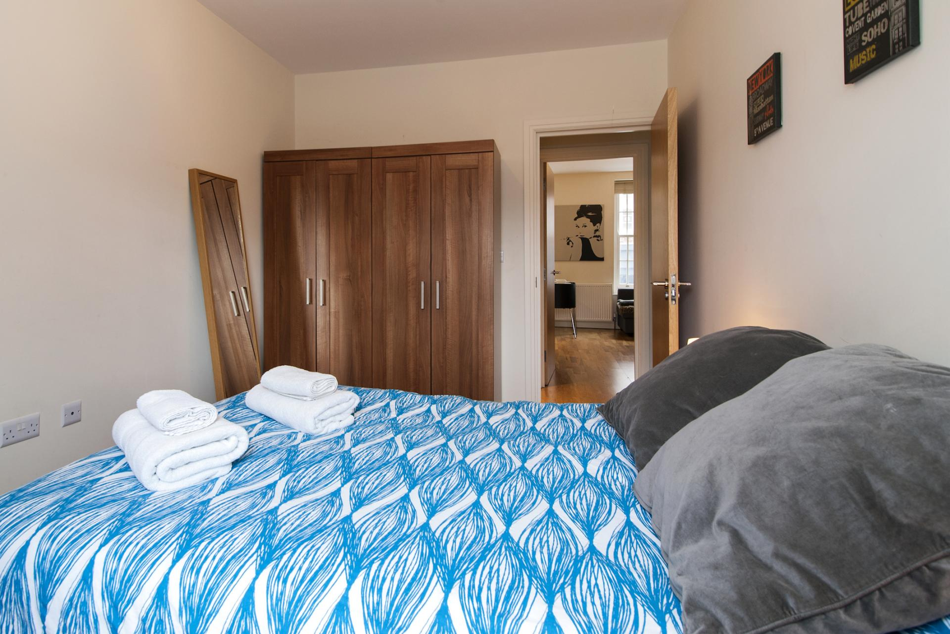 Blue bedroom at Angel Serviced Apartments