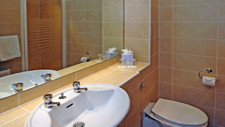 Compact bathroom in Grove Apartments