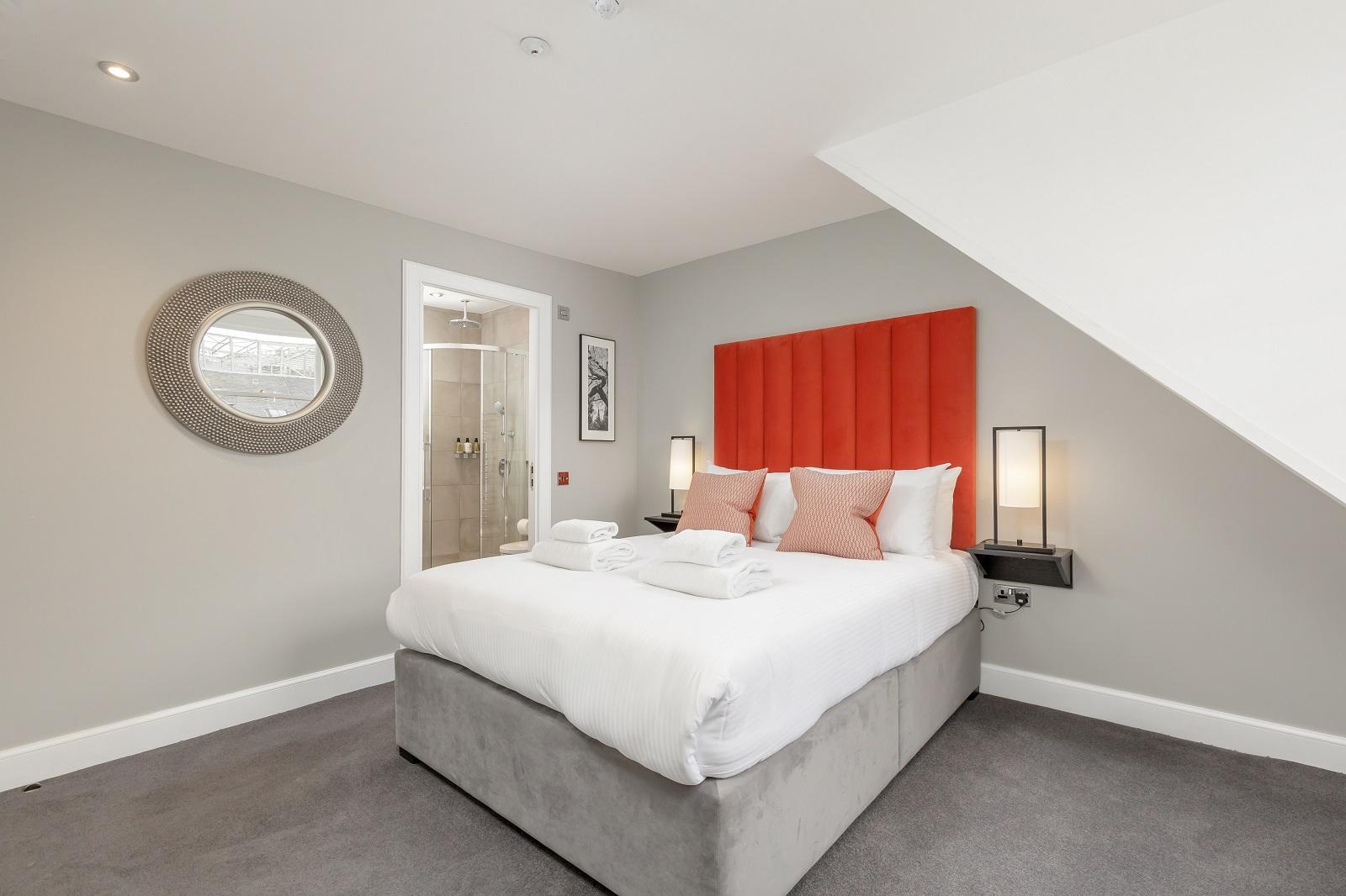 King size bed at Hanover Serviced Apartments