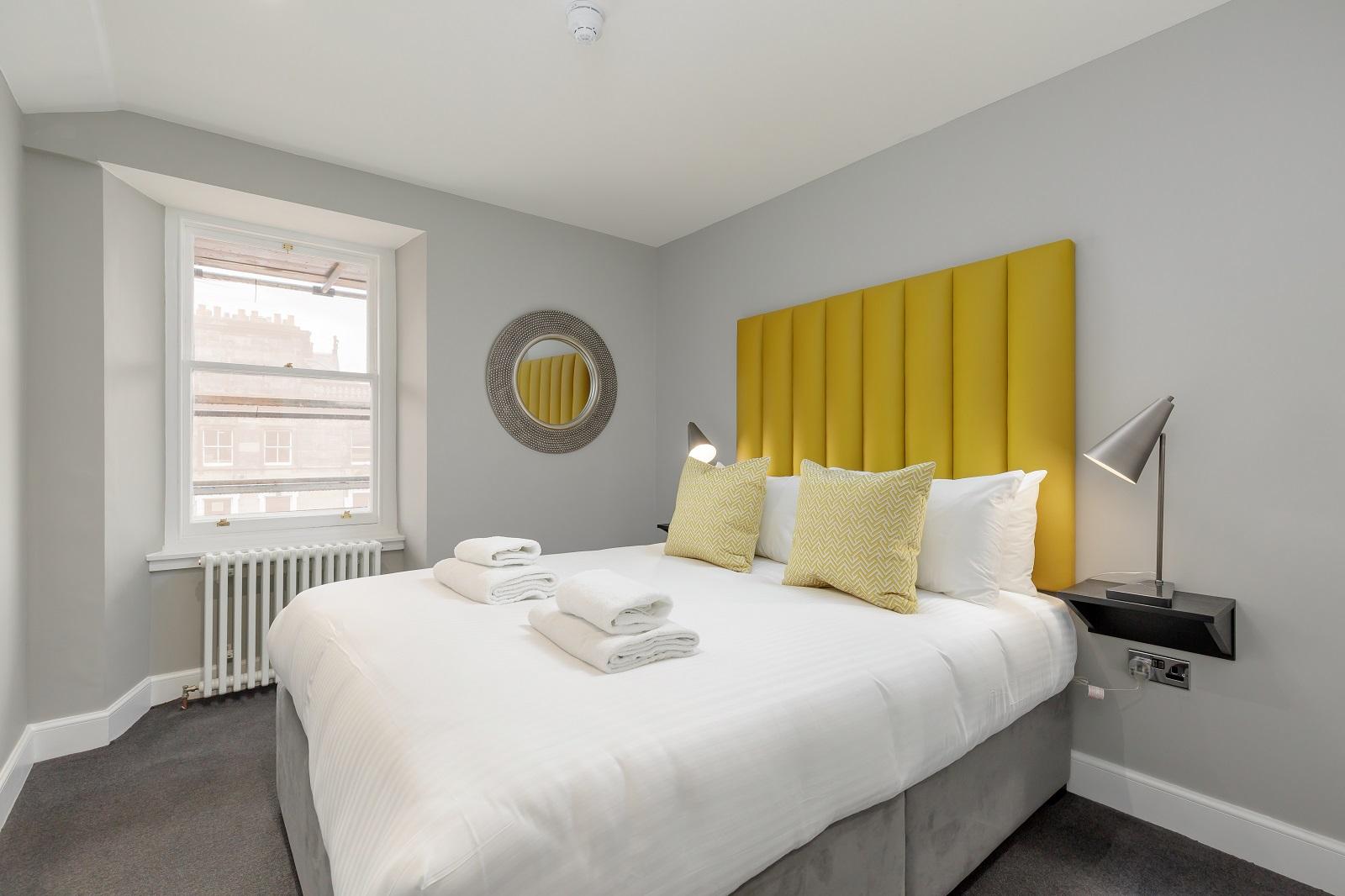 Yellow bedroom at Hanover Serviced Apartments
