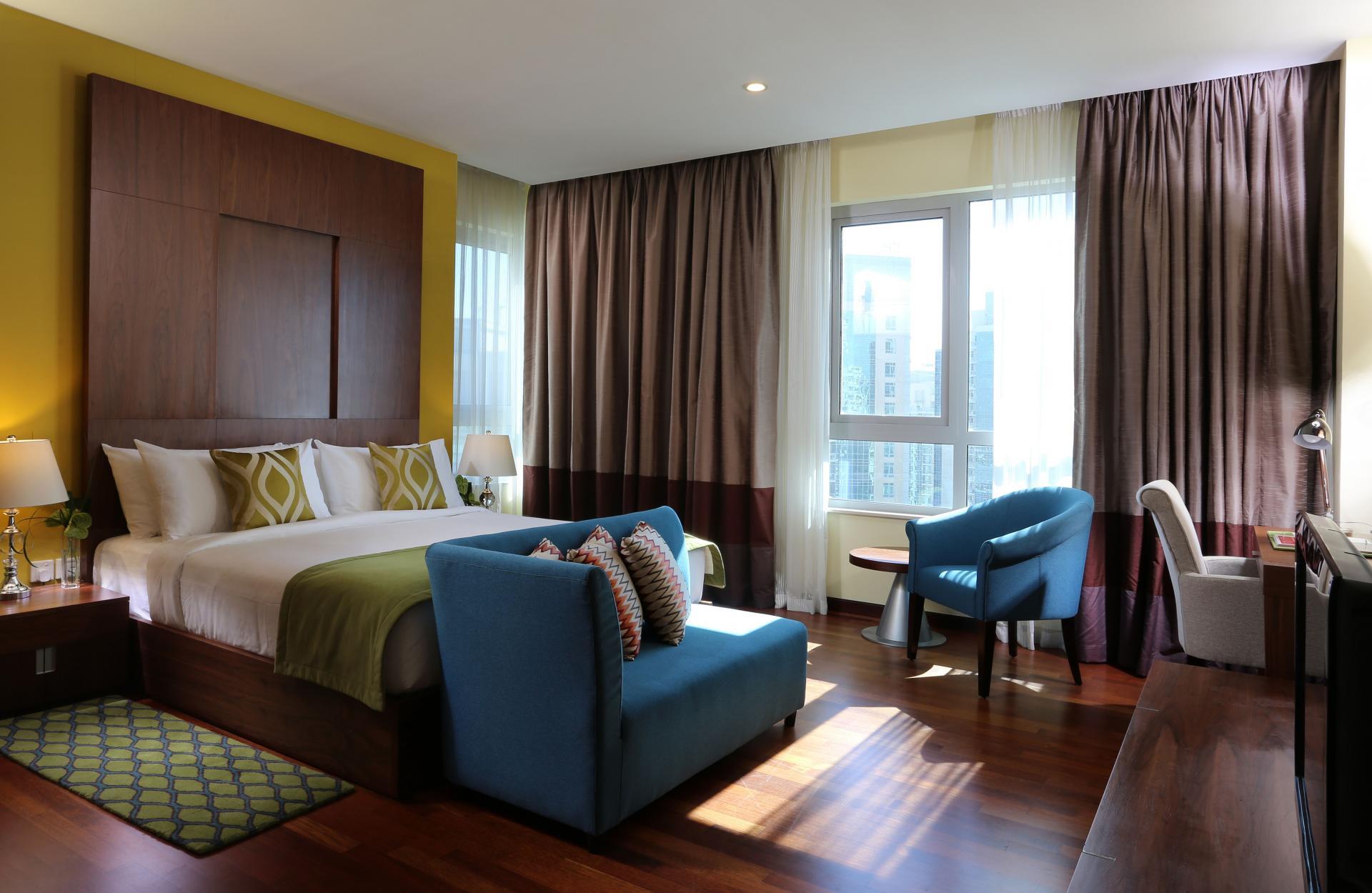 Spacious bedroom at Ramada Downtown Dubai Apartments