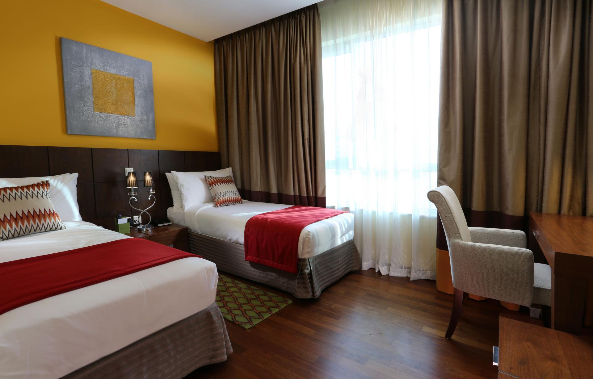 Twin beds at Ramada Downtown Dubai Apartments