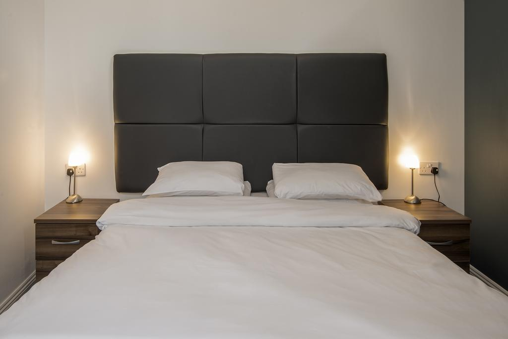 Bed at Cook Street Apartments