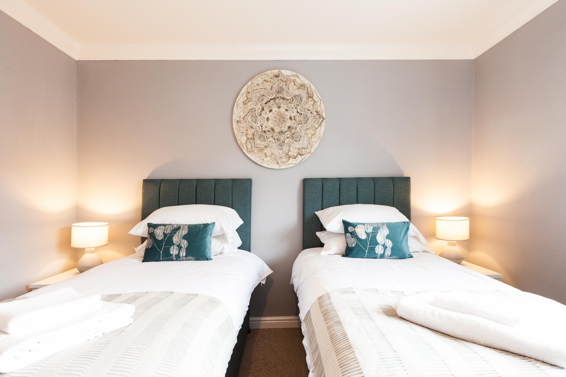Twin beds at Barry Road House, Abington, Northampton