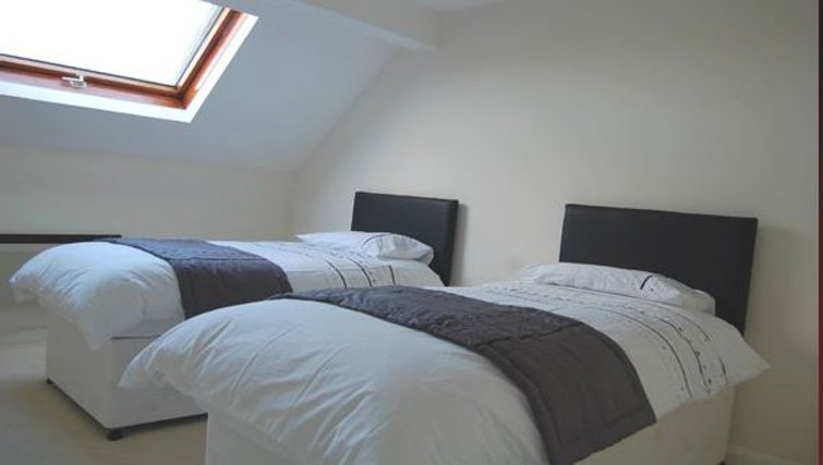 Comfortable bedroom in The Mews Apartments