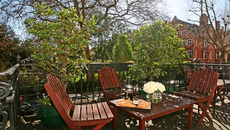 Relaxing balcony at at Collingham Serviced Apartments