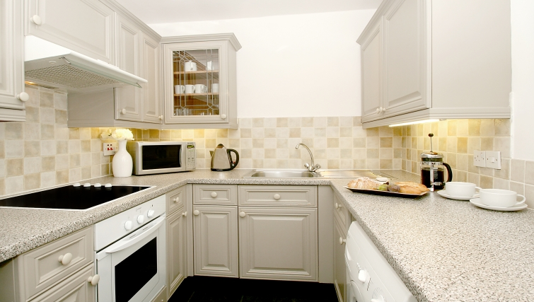Well equipped kitchen at Collingham Serviced Apartments