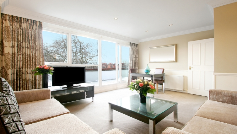 Modern living area at at Collingham Serviced Apartments
