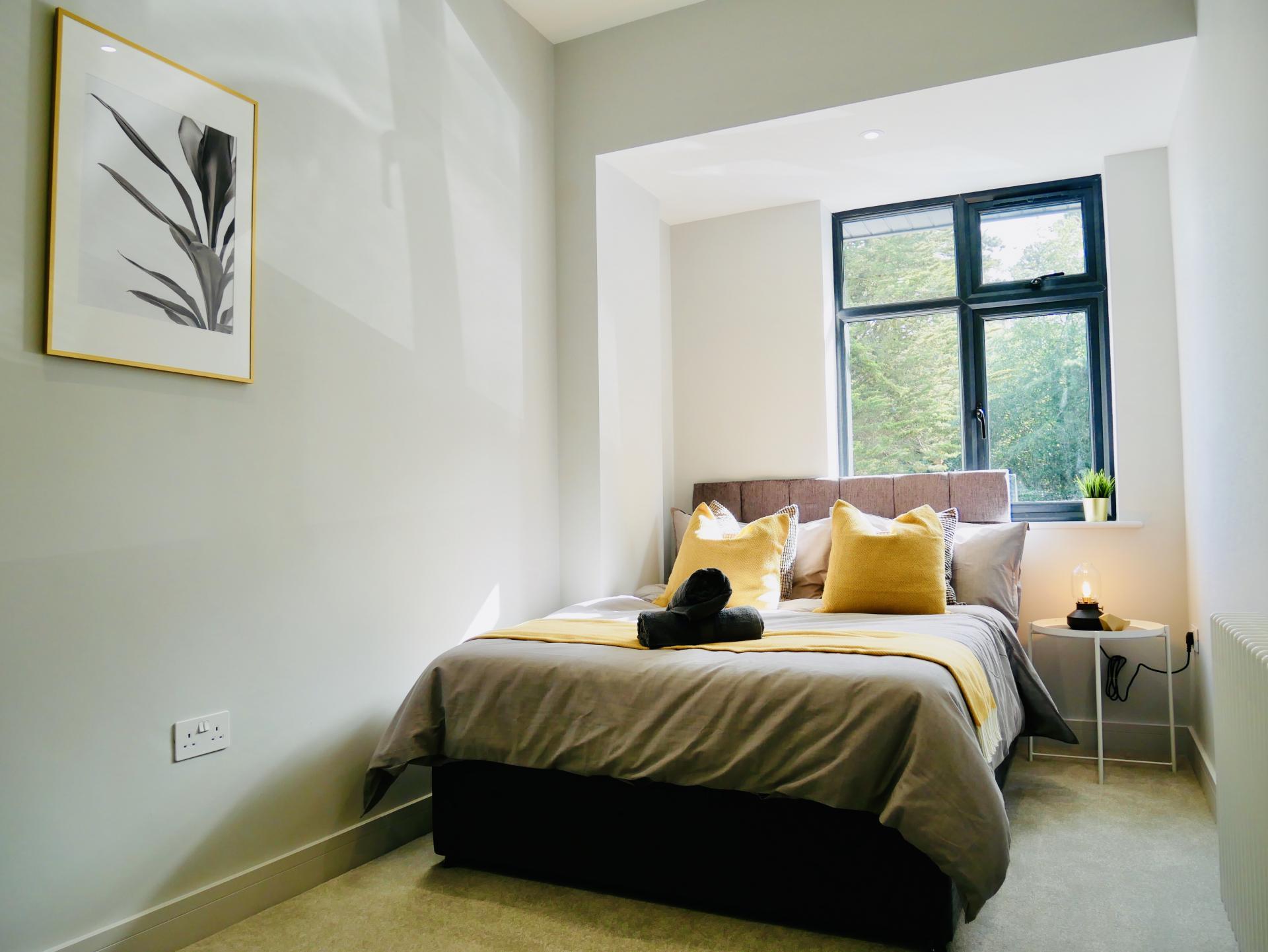 Yellow pillows at AlumPointe Apartments