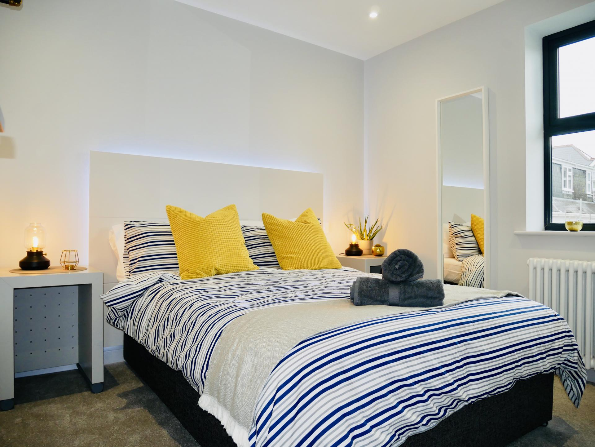 Stripy bedding at AlumPointe Apartments