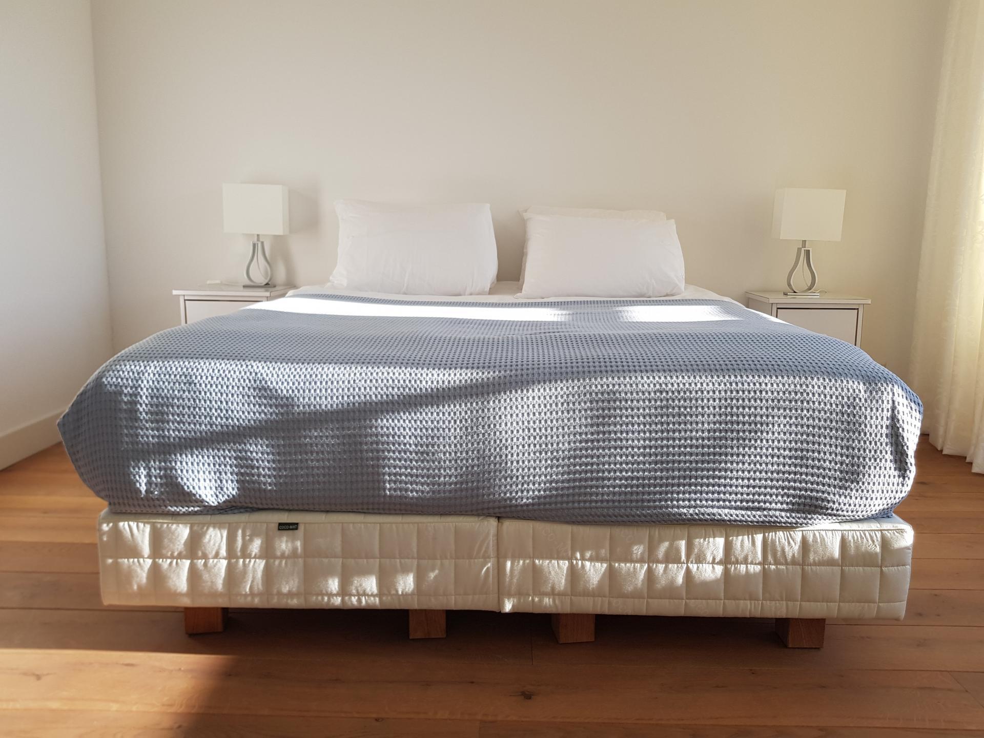 Bed at 21 Haarlemmerplein Apartments, Amsterdam