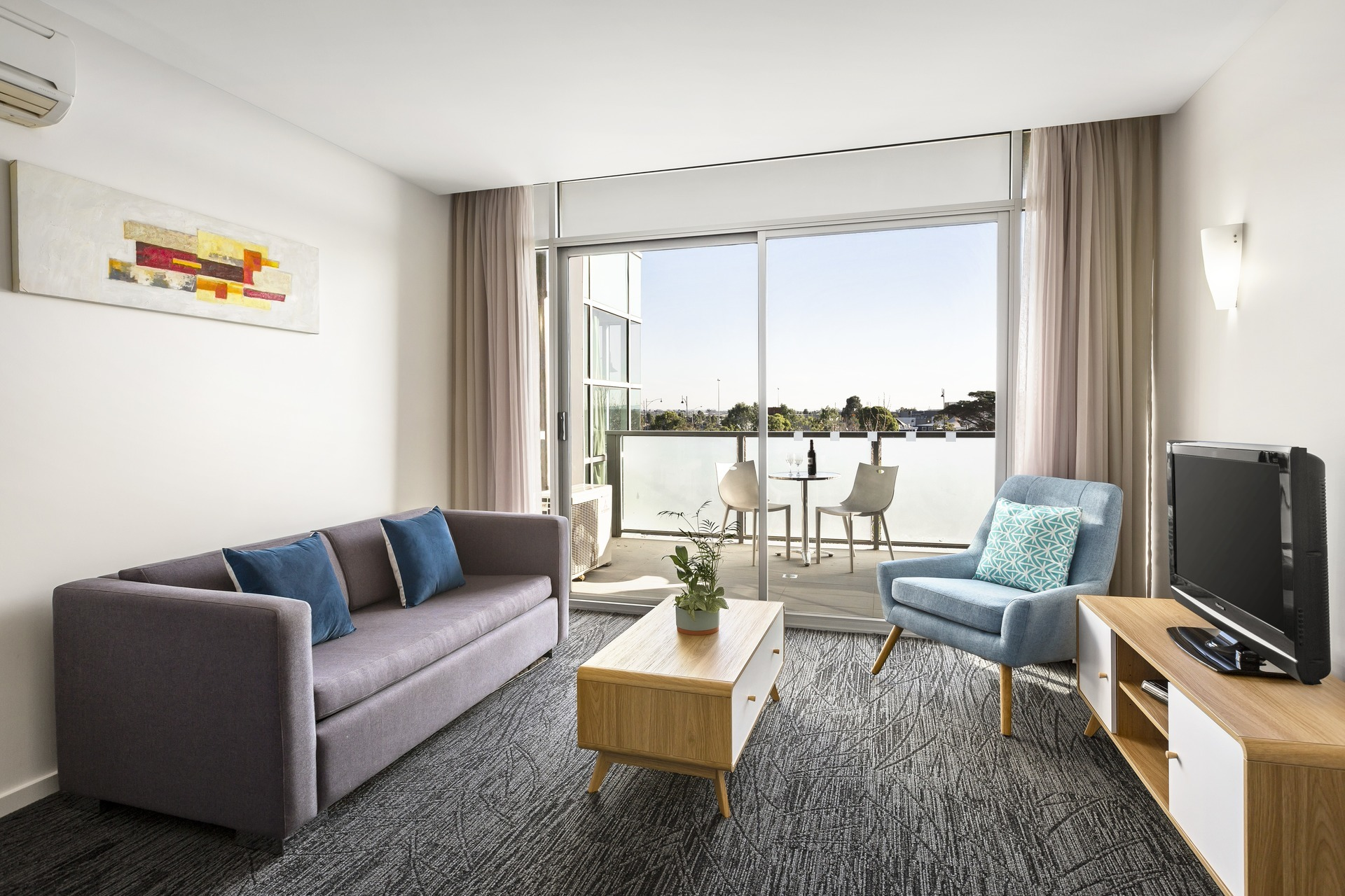 Living room at Quest Caroline Springs Apartments