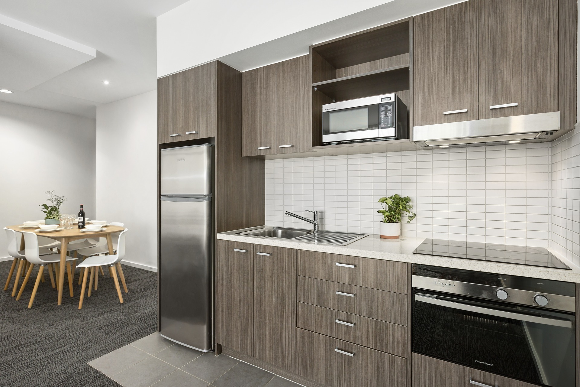 Fully equipped kitchen at Quest Caroline Springs Apartments