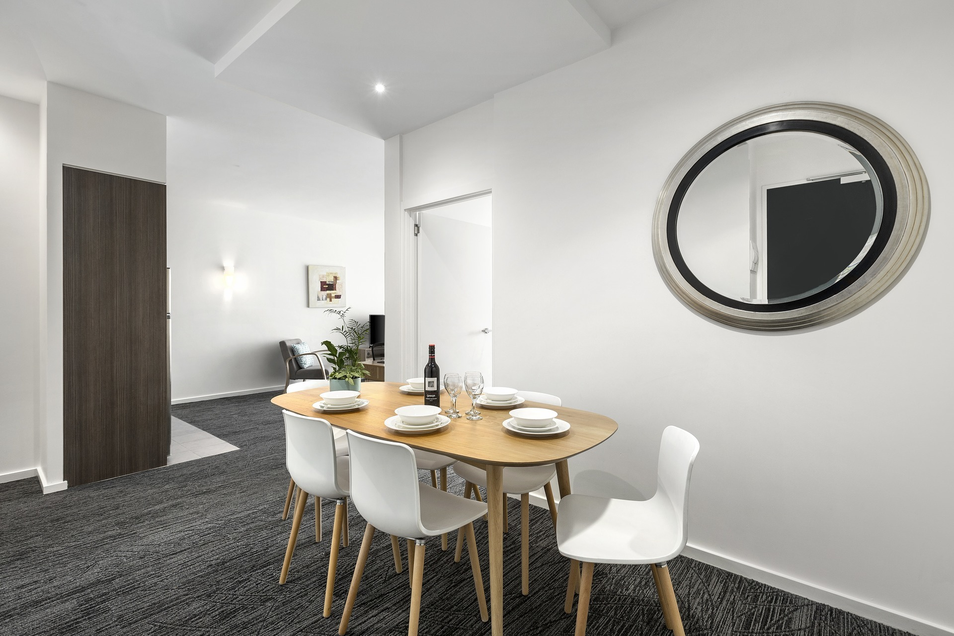 Table and chairs at Quest Caroline Springs Apartments