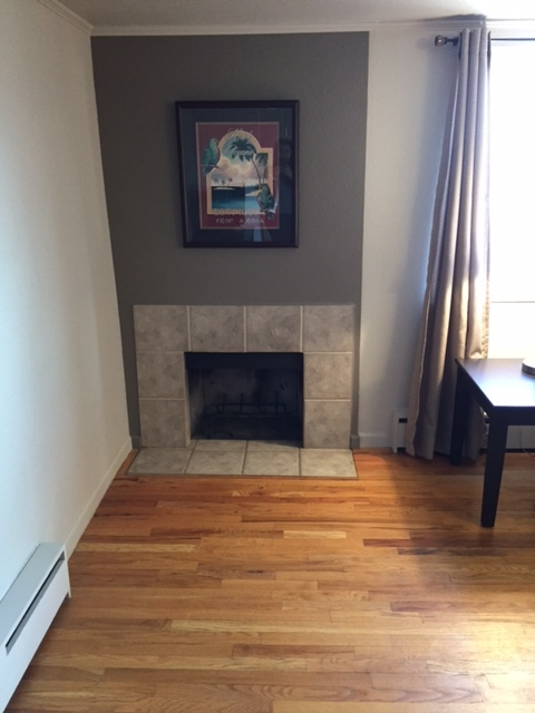 Fireplace at Grant Street Apartment