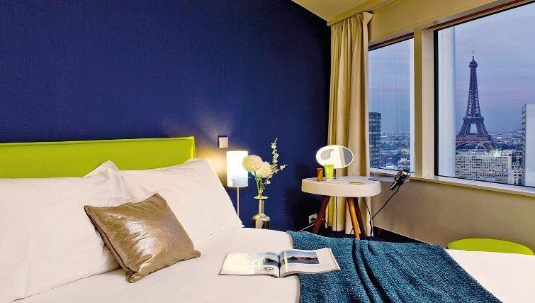 Comfortable bedroom in Adagio Paris Centre Tour Eiffel