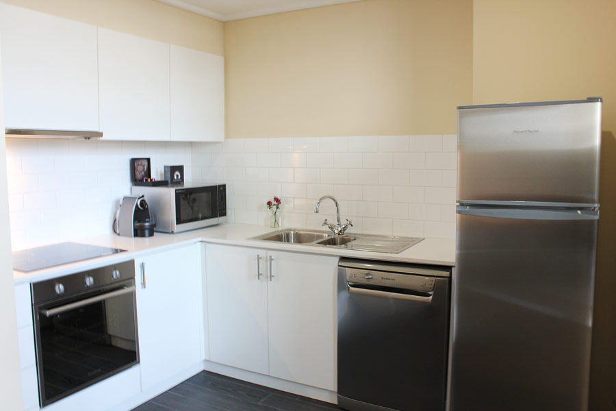 Kitchen at Quest Grand Hotel Apartments