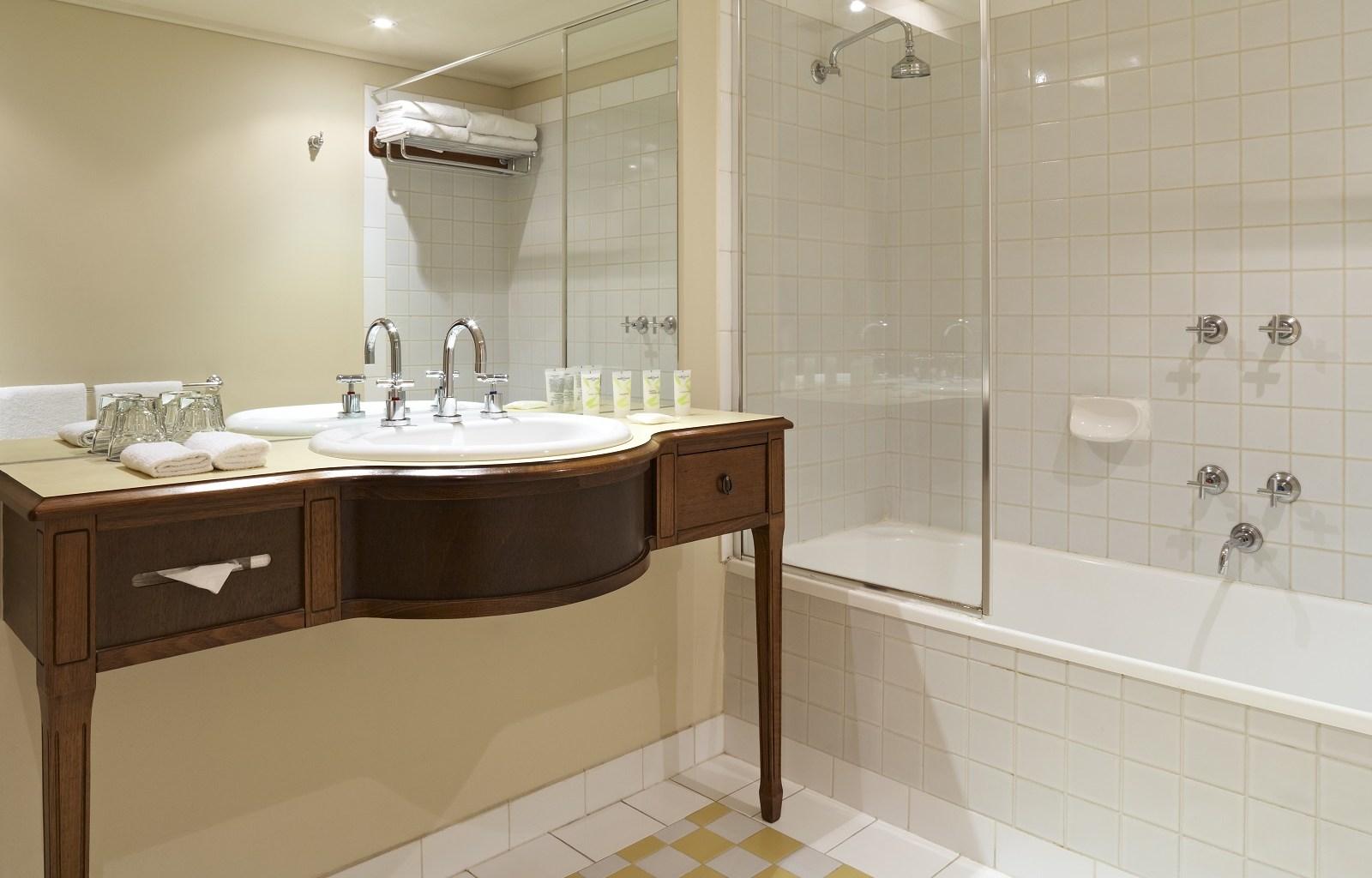 Bath at Quest Grand Hotel Apartments