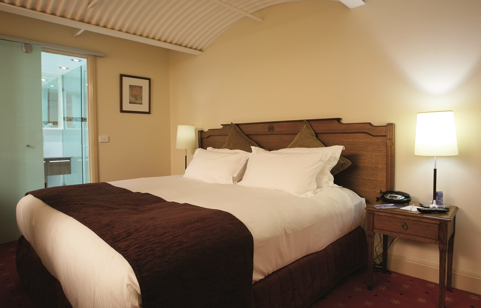 Bed at Quest Grand Hotel Apartments