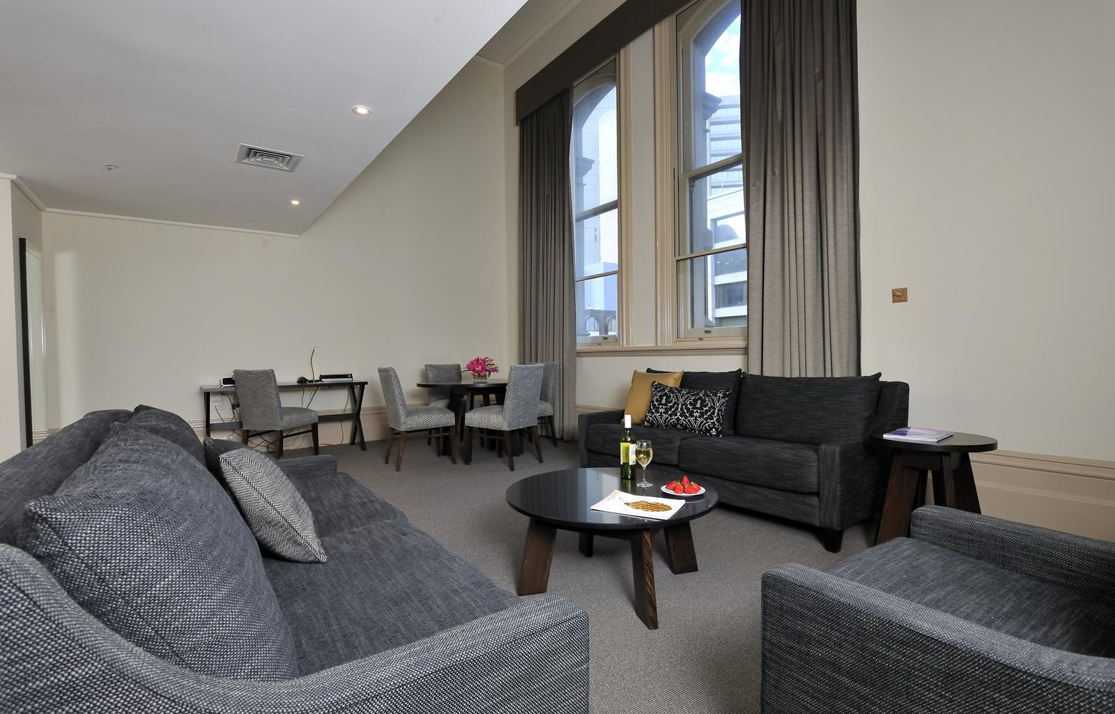 Spacious lounge at Quest Grand Hotel Apartments