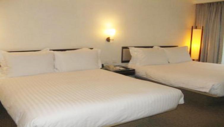 Comfortable bedroom in Regal Airport Hotel
