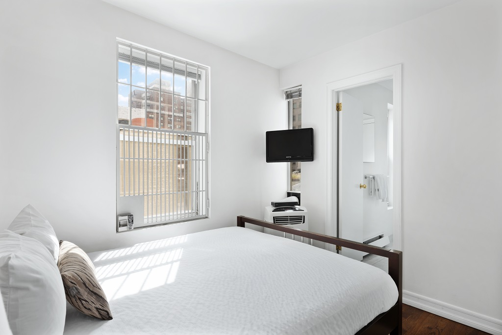 Bright bedroom at 427 East 82nd Street Apartments, Upper East Side, New York