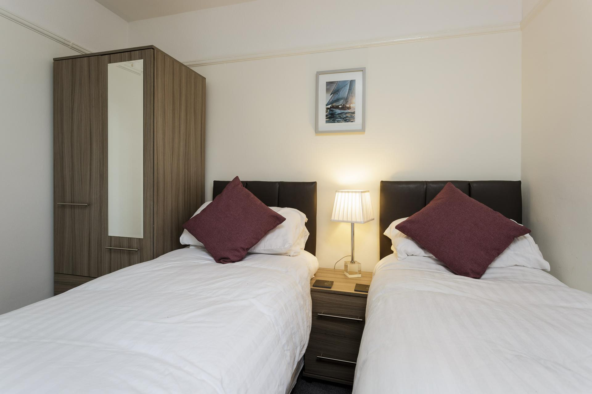 Twin beds at Braganza House Apartments, Old Portsmouth, Portsmouth