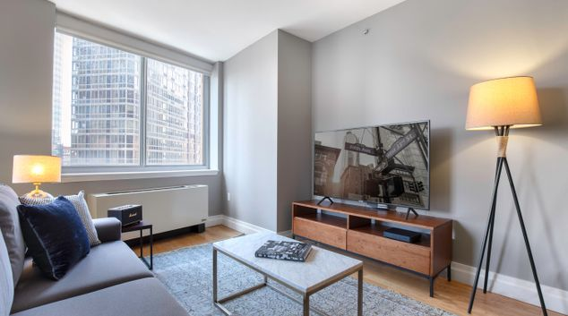 Living area at The Capitol Sixth Avenue Apartments